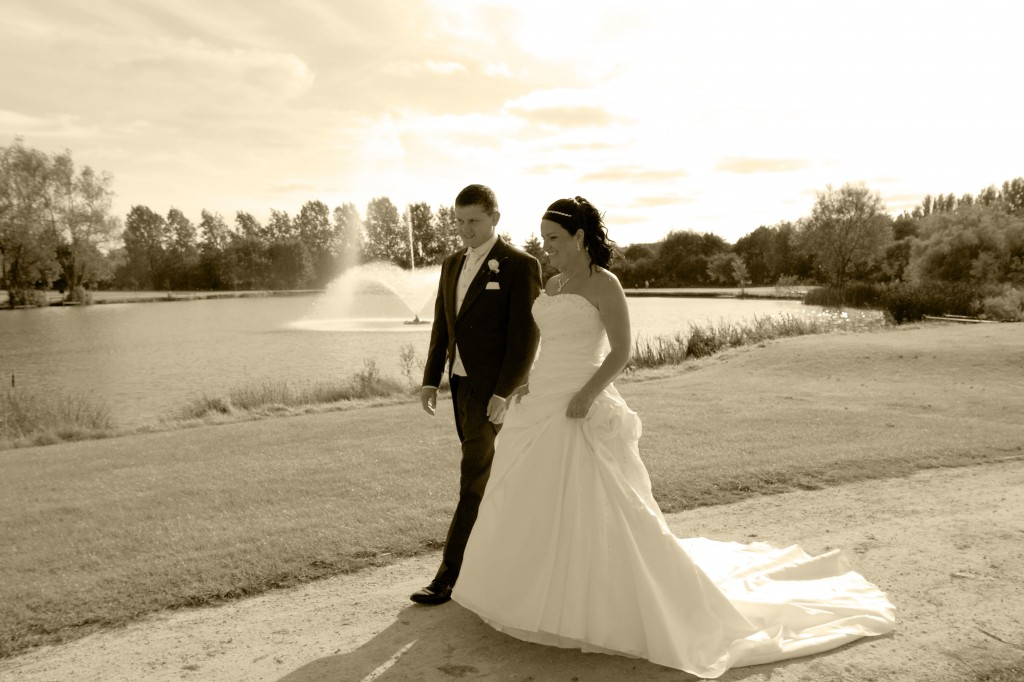 Newly married couple by lake